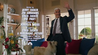 In a shot exclusive to the theatrical trailer, Leslie Nielsen smiles and waves while a dog gets personal and credits are displayed.
