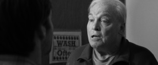 Former business partner and local karaoke singer Ed Pegram (Stacy Keach) lays claim to some of Woody's earnings while confronting David in the bathroom.
