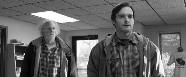 Woody (Bruce Dern) and David (Will Forte) look to claim Woody's million dollars at an office in Lincoln, Nebraska.