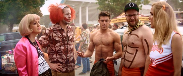 "The grown-ups of ""Neighbors 2"" go all out with wigs, masks, and drawn-on abs to steal Kappa Nu's weed."