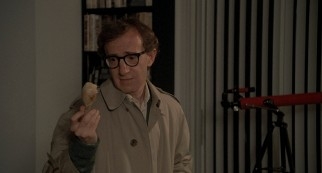 "Sheldon Mills (Woody Allen) holds and reflects upon a boiled chicken leg that reminds him of his mother in ""Oedipus Wrecks."""