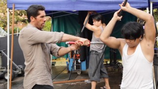 "Scott Adkins and a castmate rehearse a sword fight on the set of ""Ninja: Shadow of a Tear."""