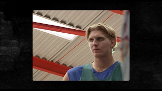 A young Dirk Nowitzki sports a fashionable '90s hairdo.