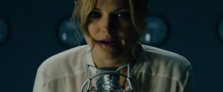"Malin Akerman is Katherine, a civilian ""broadcaster"" of encrypted number codes."
