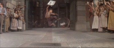 Freeze frame newsboy leap in the air. Success!