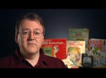 "Animation producer/historian Hans Perk talks in front of 101 Dalmatians books in the 2008 documentary ""Redefining the Line."""
