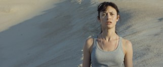 Julia (Olga Kurylenko) is surprised by what she finds in the post-apocalyptic desert.