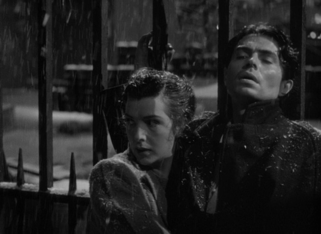 "Kathleen (Kathleen Ryan) tries to usher Johnny (James Mason) to seclusion in the snowy climax of ""Odd Man Out."""