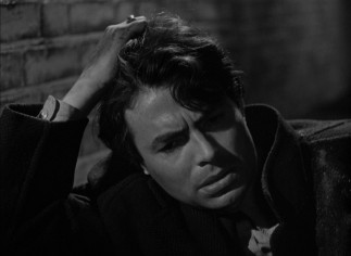 After falling out of a car, the wounded Johnny McQueen (James Mason) becomes the odd man out in an air raid shelter.