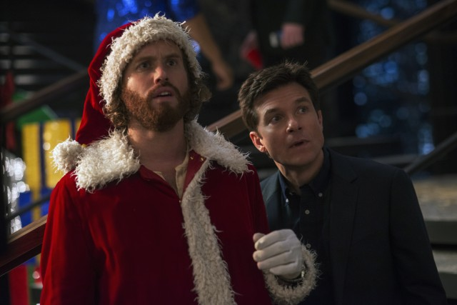 "Clay Vanstone (T.J. Miller) and Josh Parker (Jason Bateman) throw an office Christmas party in ""Office Christmas Party."""