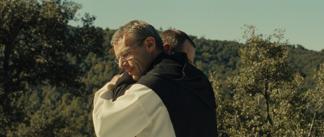 In front of Morocco playing Algeria, Brother Christian (Lambert Wilson) gives his fellow monk a great hug. Ah, the greatest hug!