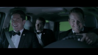 Gerard Butler and Cole Hauser share a laugh on a green screen drive in the Olympus Has Fallen gag reel.