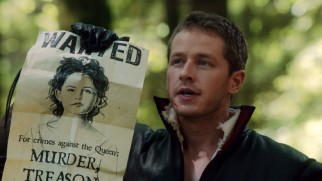 In a fairy tale sequence, Prince Charming (Josh Dallas) holds up the Wanted poster calling for Snow White's arrest.
