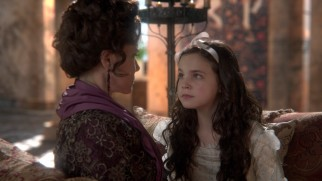 "A young Snow White (Bailee Madison) lets out a damning secret to the Queen's vindictive mother (Barbara Hershey) in ""The Stable Boy."""