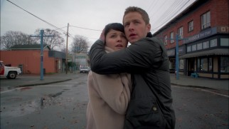 Mary Margaret (Ginnifer Goodwin) and David (Josh Dallas) brace for the purple CGI smoke coming their way in the first season finale.