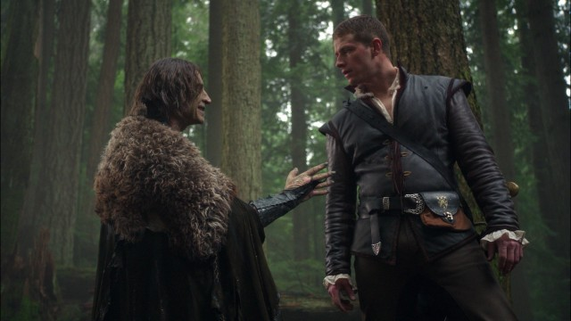 Rumplestiltskin (Robert Carlyle) and Prince Charming (Josh Dallas) make a deal in the woods of fairy tale land.