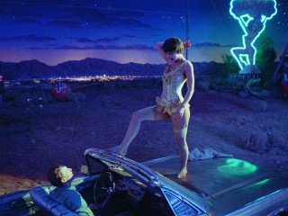As circus tightrope artist Leila, Nastassja Kinski puts on a little show for Hank (Frederic Forrest) in the junkyard where he works.