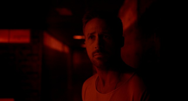 No primary color gets neglected in Nicolas Winding Refn's stylized visuals. Here, red gets its chance to tint a silent Ryan Gosling.
