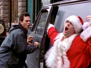 Though this looks bad for Mark Ruffalo, this Santa (David Hewlett) is bad, has it coming, and has a wrist cast to cushion the blow.