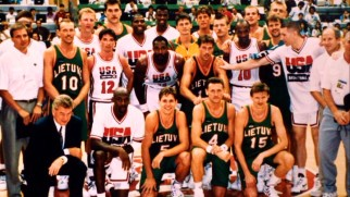 The Lithuanian Olympic basketball team poses for their obligatory photograph with the U.S. Dream Team.