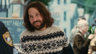 Ned Rochlin (Paul Rudd) dons a sweater and a smile in front of the police officer who is about to lead to jail time.