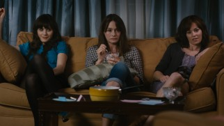Things get real for Ned's three sisters (Zooey Deschanel, Emily Mortimer, and Elizabeth Banks) during a strained family game of charades.