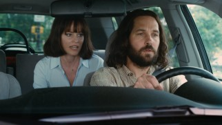Ned (Paul Rudd) lends his driving services to Miranda (Elizabeth Banks) as she talks with an important lady.