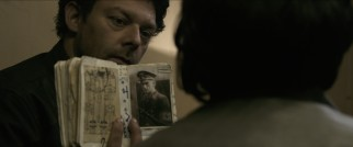 Wallace (Richard Coyle) reveals to Lena that reports of some Nazi camp commanders' deaths have been greatly exaggerated.