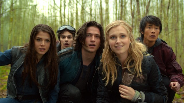 "In ""The 100"" juvenile delinquents dropped from space get their first look at Earth's wildlife post-nuclear apocalypse. Their smiles soon disappear."