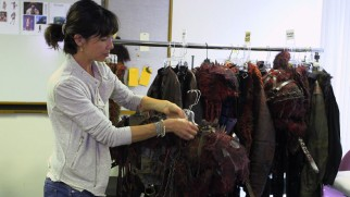 Costume designer Katia Stano shows off some of the Grounders' distinct wardrobe offerings.