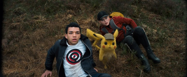 "A human man (Justice Smith), his father's Pikachu (voiced by Ryan Reynolds), and an aspiring reporter (Kathryn Newton) go digging for answers in ""Pokémon: Detective Pikachu."""