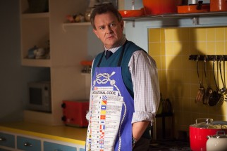 Mr. Brown (Hugh Bonneville) isn't crazy about the notion of putting up a bear in his house.
