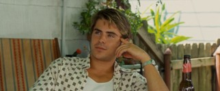 Stretching himself, Zac Efron plays Jack Jensen, a college dropout who expresses himself with speech, not song.