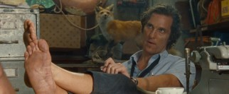 As one fox looks on, another (Matthew McConaughey) throws a bone to foot fetishists with his working pose.