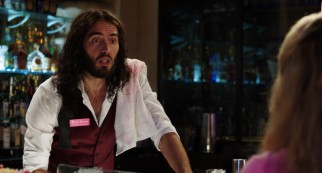 """Sweet"" William Carr (Russell Brand) serves Lamb her first alcoholic drink and reconnects with her later in the night."