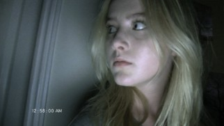"During a video chat with her boyfriend, Alex Nelson (Kathryn Newton) hears something in ""Paranormal Activity 4."""