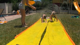 "Boys will be boys, even creepy ones: hence this scene of Robbie and Wyatt getting their Slip 'n Slide on in ""The Recovered Files."""