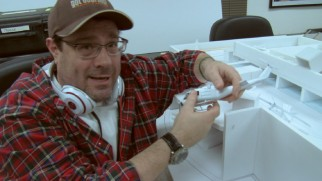 Director Andy Fickman shows off plans for an action sequence in miniature model form.