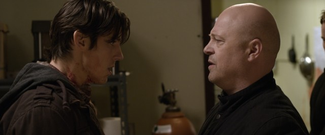 "Derrick (Michael Chiklis) explains how it's gonna be to bloodied young ex-con Nick Davenport (Sean Faris) in ""Pawn."""