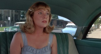 Peggy Sue (Kathleen Turner) takes a new look at her old neighborhood.