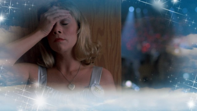 Peggy Sue (Kathleen Turner) laments the lack of bonus features on her Blu-ray Disc's menu.