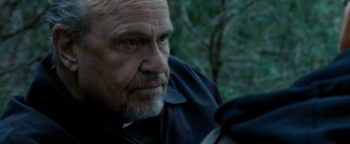 "Fred Dalton Thompson plays Father Charles Luther, a Catholic priest John just calls ""Dad."""