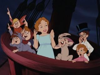 Wendy, John, Michael, and the Lost Boys cheer on as Peter Pan stands up to Captain Hook.
