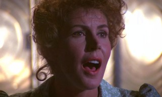 "Nora (Helen Reddy) sings the Oscar-nominated ""Candle on the Water"" from up in her lighthouse."