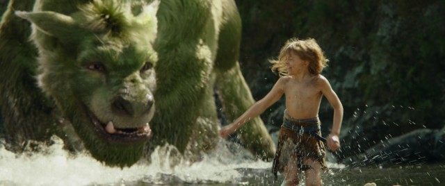 "The feral orphan Pete (Oakes Fegley) and his best friend Elliot frolic around in the water in 2016's ""Pete's Dragon."""