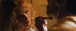 Independent chairmaker Lace (Kyra Sedgwick) gives George a romantic shave.