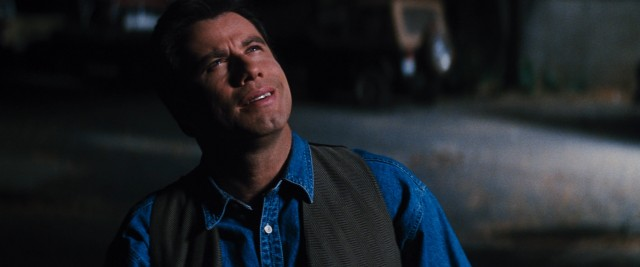 37-year-old George Malley (John Travolta) sees bright lights in the sky approaching Earth. What does it mean? Phenomenon! Do-doo-do-do-doo.