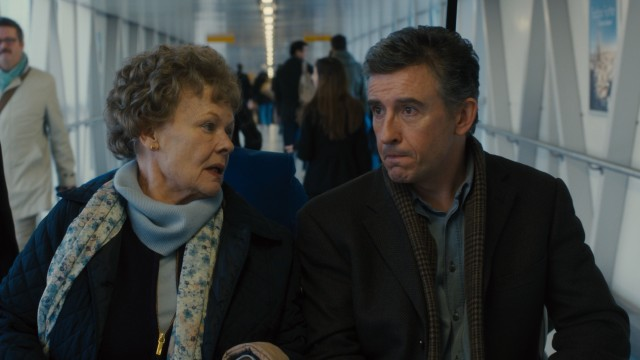 "Philomena Lee (Judi Dench) explains the romance novel she just read in great detail to journalist Martin Sixsmith (Steve Coogan) in #54, ""Philomena."""
