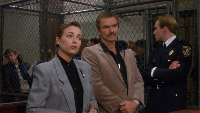 "Public defender Jennifer Hudson (Theresa Russell) gladly represents Joe Paris (Burt Reynolds), a suspended Boston cop accused of first degree murder in ""Physical Evidence."""