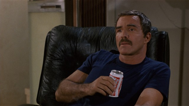 "Beer-swilling suspended Boston cop Joe Paris (Burt Reynolds) finds himself in a mess in ""Physical Evidence."""